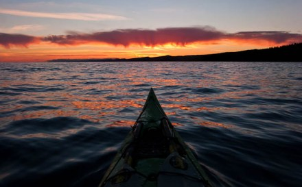 A kayak and an expanse of Lake Superior at sunset.