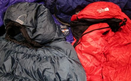 Down and synthetic sleeping bags in a pile.