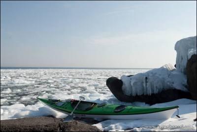 kayak in winter on Lake Superior's shore