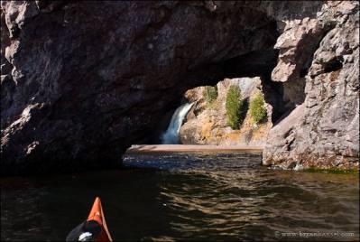 Kayaking through a sea arch on Lake Superior at the Manitou River