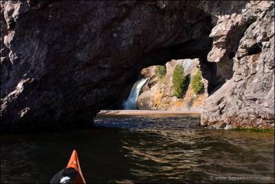 Kayaking through a sea arch on Lake Superior at the Manitou River