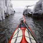 Winter sea kayaking near ice.
