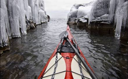 Winter kayaking near ice.