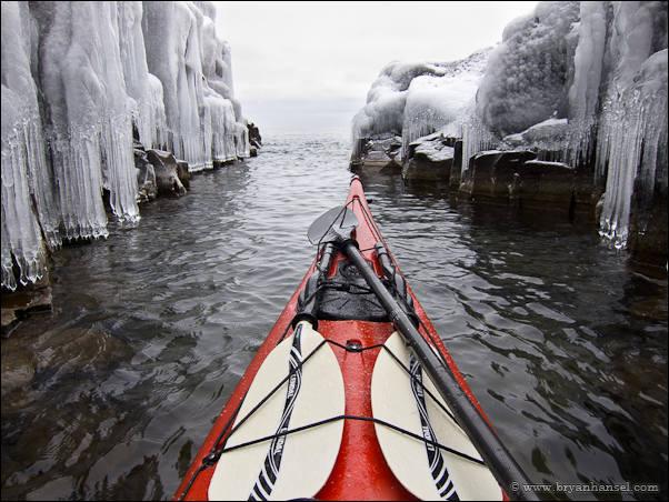 Winter kayaking near ice.