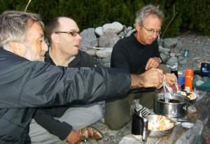 Camping on Lake Superior eating food.