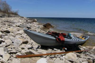 Kayak on limestone beach near Marble Head
