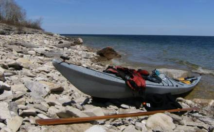 Kayak on limestone beach near Marble Head