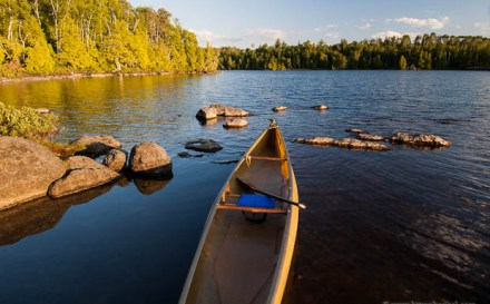 A solo canoe on Lake Alice in the Boundary Waters Canoe Area Wilderness, Minnesota, USA.