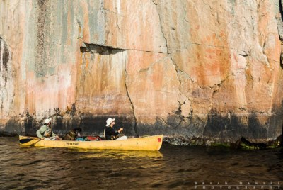canoeing past pictographs in the wilderness