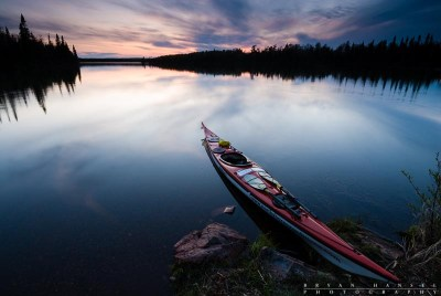 A kayak on the shore of Cascade Lake at sunset.