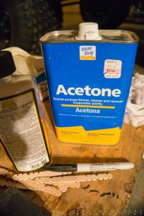 Acetone, Goo Gone and a marker.