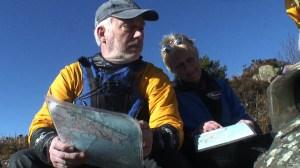 kayakers looking at charts