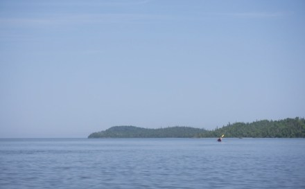 kayaker paddling to Pigeon Point