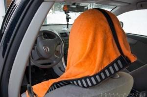 Transition towel pocket over a car seat