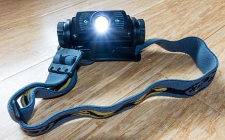 Fenix HL60R headlamp with light on