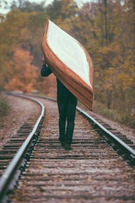 portaging a cedar strip canoe on railroad