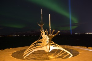 The Sun Voyager at night, with Aurora Borealis.