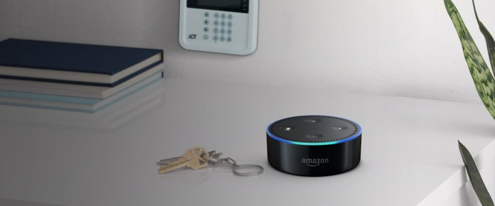 A photo of an Echo dot near an ADT pulse control pad