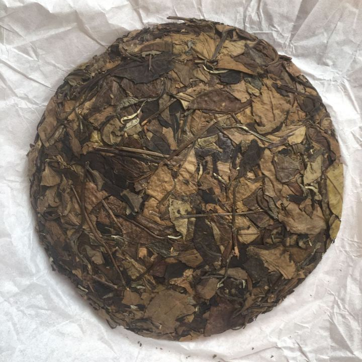 Old tea leafs processed as white tea and pressed into the 357g cake