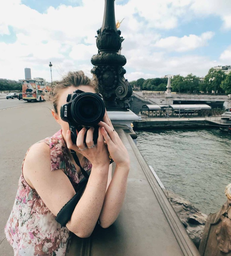 paige gribb behind the scenes with camera during a photoshoot in paris