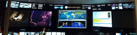 Second view of the screens of the ISS Mission Control, with recorded data from previous spacewalks.