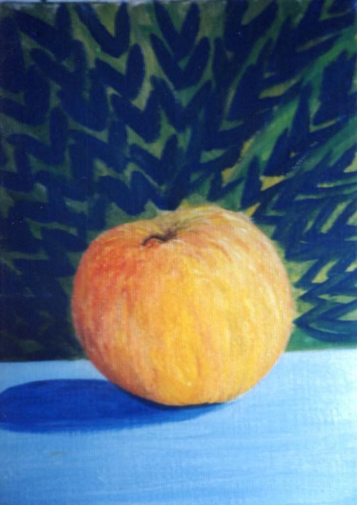 apple on blue cloth