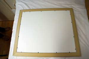 """Acid free mat and backing boards held in place with flexible """"points"""""""