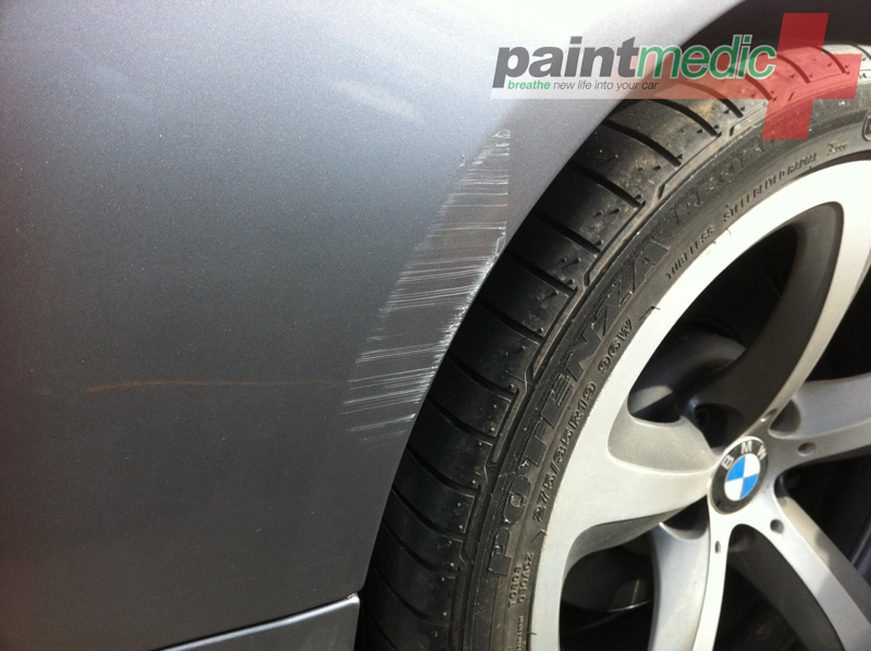 Car scratch before Paintmedic repair