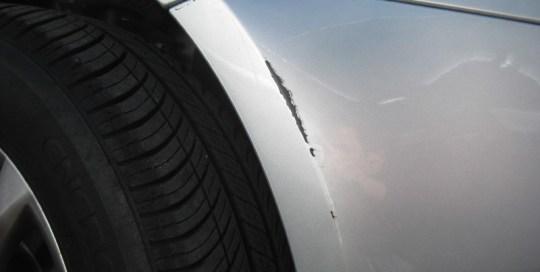 Cracked wheel arch before Paintmedic repair