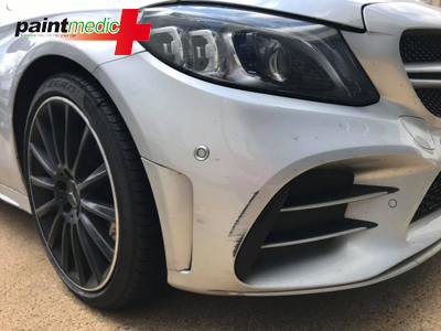 A Mercede Benz bumper scuff awaits repair