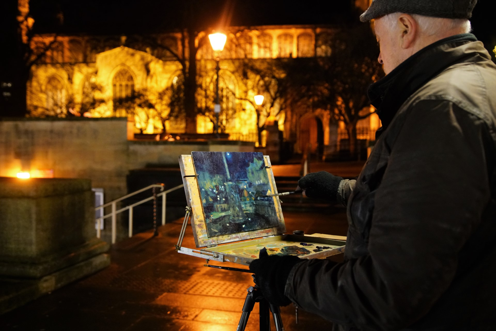 Artist Richard Bond painting from the Market at Paint Out Norwich Winter Nocturne