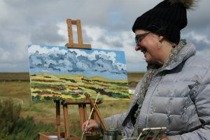 Artist Mary Blue Brady painting a pair of artworks at Blakeney, Paint Out Wells 2017. Photo by Katy Jon Went