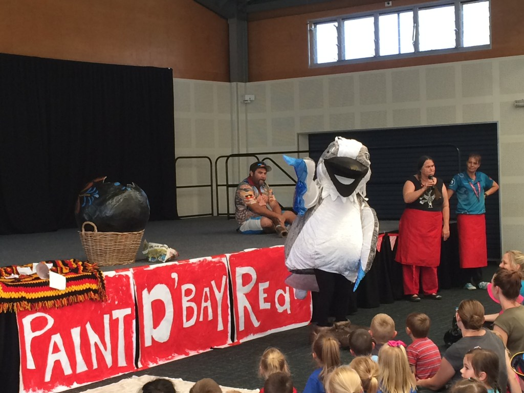 Kookaburra mascot with seated children at launch