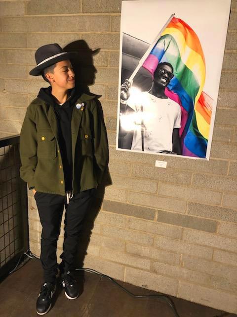 "Beltran poses proudly next to ""Pride."""