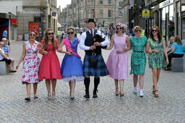 Adrian Hood with girls who started their hen party watching the pipe band championship