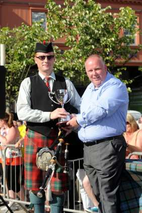 David Bruce Dumbarton and district Pipe Band rec the Craig Hepburn Memorial Trophy from Alex Hepburn