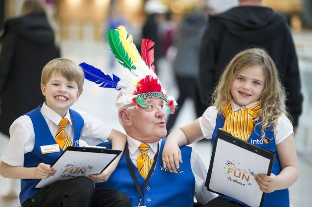 The new intu Braehead Heads of Fun, Aidan Smith and Lucie Roy get to work with shopping centre cleaner, Finlay Smith.