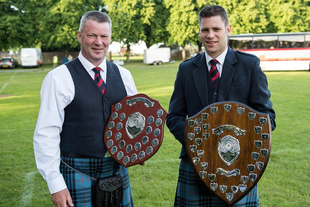 Pipe Majors Keith Bowes Sr & Jr with their respective trophies.