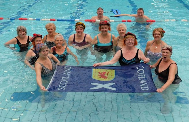 Swimmers enjoy a Splashing White Sergeant and a Spray Gordons atj the Aqua Ceilidh, held at Renfrew Victory Baths for St Andrew's Day