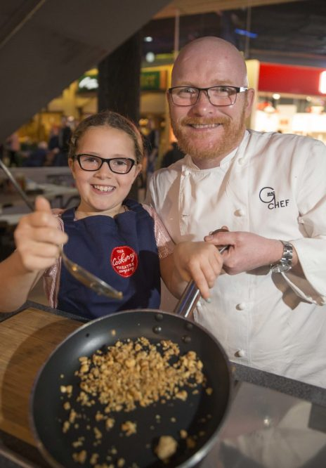 23/09/17… SOAR - INTU BREAHEAD. Master chef champ Gary Maclean with young Sophie Yates as he gave shoppers cooking demonstration in soar intu breahead