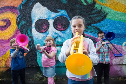The Wee Spree festival, Paisley - Musician Colin Hyson rehearses for The Wee Spree festival, with school kids Gordon McCallum, 8 (blonde hair, blue t-shirt) Callum Gemmell, 9 (glasses and check shirt), Holly Beggs, 9 (pink tshirt), Imogen Hunter, 9 (rainbow tshirt)