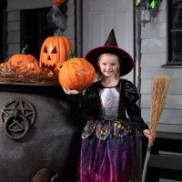 Ava casts a fun spell at Witch's Garden