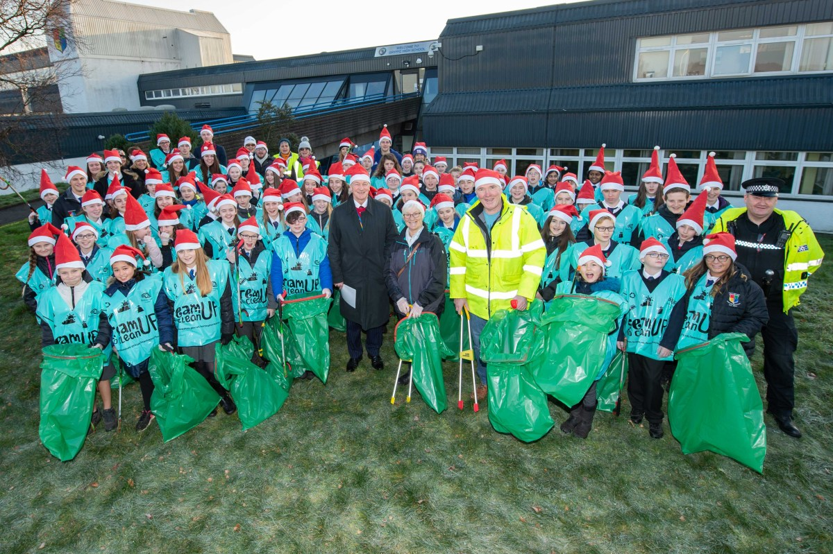 School pupils become Santa's little helpers to brighten up their local community