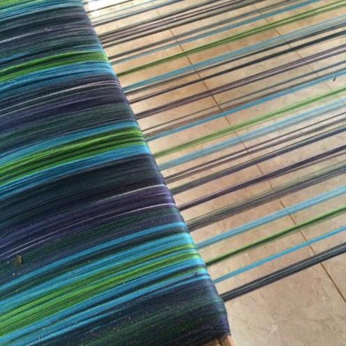 Fair trade tartan threads on loom