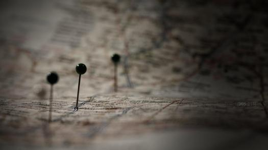 Photo of pins on a paper road map
