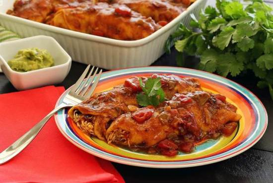 Slow cooker paleo and gluten free chicken enchiladas recipe from PaleoNewbie.com