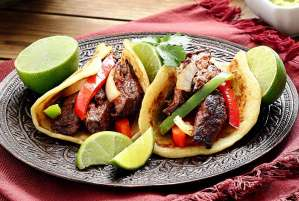 easy paleo recipe for steak fajitas made with paleo tortillas