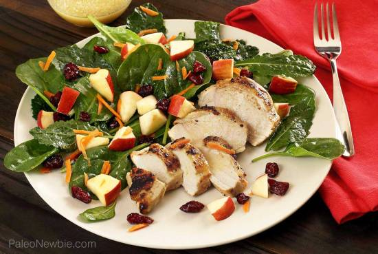 simple paleo salad featuring kale with added spinach, apples, cranberries and more.