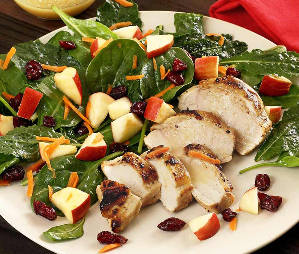 Easy paleo recipe for a kale, spinach and apple salad with a special lemon vinaigrette dressing