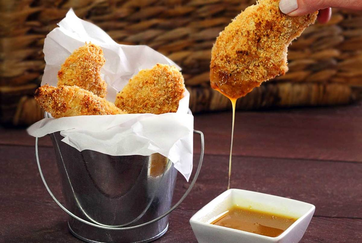 easy paleo recipe for baked chicken fingers with a simple honey-mustard dipping sauce